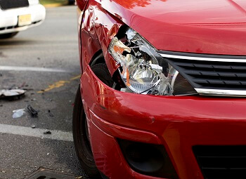 closeup of a car with a smashed headlight