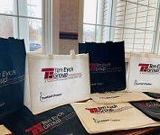 Reusable bags with the Ten Eyck Group logo on them